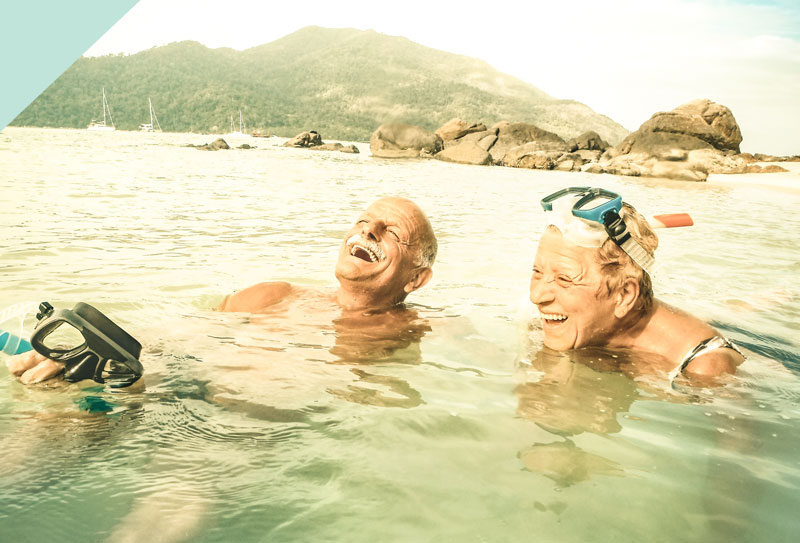 An older couple swimming in the sea