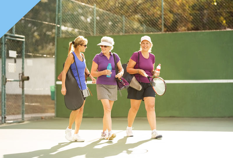 Three ladies preparing to play tenis