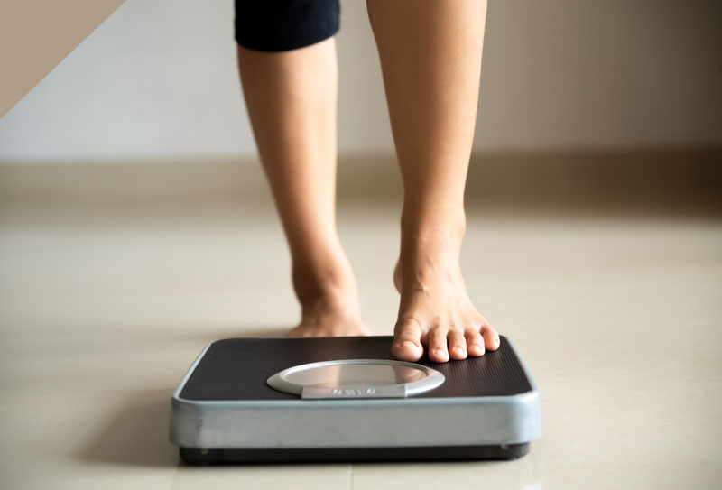A Person standing on a weighing scales
