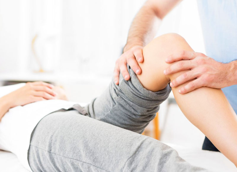 A patient receiving treatment on their knee